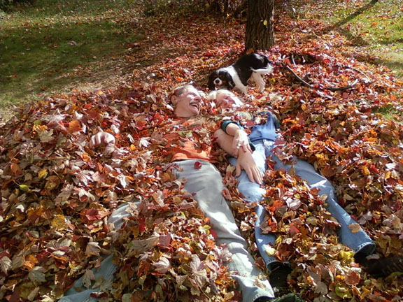 Kathleen, Breighton, and dog Tessa in leaves